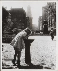 Child drinking from water fountain, Gramercy Park